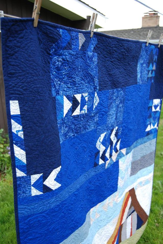 Abstract mountain and flying geese quilt