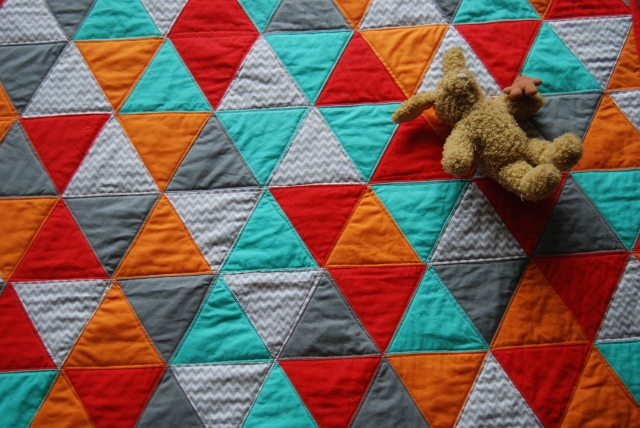 Bright triangle quilt from thelittlewaffleflowerblog.com